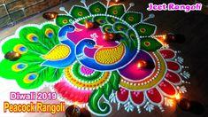 Big and beautiful peacock rangoli for Diwali. Rangoli Designs Peacock, Rangoli Designs Simple Diwali, Rangoli Designs Latest, Simple Rangoli Designs Images, Free Hand Rangoli Design, Rangoli Patterns, Small Rangoli Design, Rangoli Border Designs, Rangoli Ideas