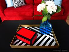 Homey Oh My! | DIY black, white, and gold coffee table tray using spray paint.