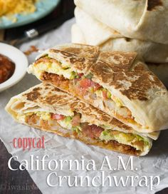 Get ready for the ultimate breakfast on-the-go with this CopyCat California A.M. Crunchwrap. It's stuffed with fluffy eggs, melted cheese, crispy hash browns, smoky bacon, creamy California avocado and fresh pico de gallo all wrapped up in a tortilla and grilled to perfection!!