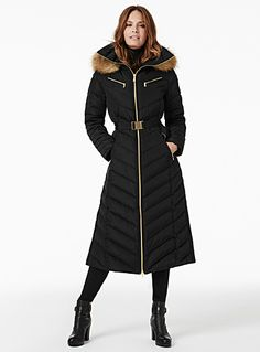 Michael Michael Kors at Contemporaine   Quilted graphic chevron seaming accented with ultra chic and elegant gold hardware   Long-line style that offers maximum protection with warm feather and down insulation   Removable hood with a genuine fur ruff   Feminine style with a belt included that flatters the waist   Side zips for greater ease of movement    The model is wearing size small