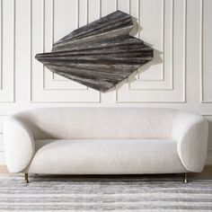 KELLY WEARSTLER | LUCIEN SOFA. Clean and tailored sofa with swooping curves and brass legs