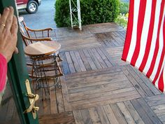 These homeowners took old wood pallets and turned them into a beautiful front porch. Check out this pallet porch project for some upcycling inspiration! Pallet Porch, Pallet Decking, Diy Porch, Diy Pallet, Porch Ideas, Pallet Ideas, Backyard Ideas, Pallet Furniture Designs, Wooden Pallet Furniture
