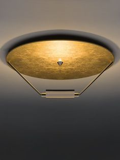Ceiling lamp - Disco - Materials and colours made with white disk and white color frame, nickel or satin nickel or with hard leaf coated gold, silver or copper and nickel structure.
