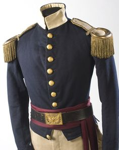 "This uniform is not instantly associated with a specific corps, though we believe it to be a New York coat dating as early as the 1850s.  The cut and style generally matches Todd's cryptic description given for the 74th Regiment NYSM that in 1854 wore a ""dark blue tailcoat and pants, trimmed with buff; black felt dress hat, and white pompon.""  Most interesting are the early low-medium convex Army General Staff buttons having a raised spread-wing American eagle surrounded by 24 stars (detail)"