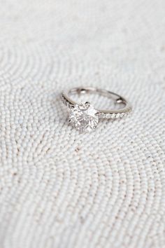This is beautiful and simple. LOVE that it's a solitaire diamond with a tiny diamond band...perfect!