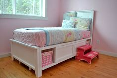 Wow! I'm not the only crazy person considering making my kid's bed (just so I can get it exactly the way I want it without paying top dollar). And this gal is kind enough to post her plans online for free. I like this one, except turn the storage cubbies into drawers that run the entire width of the bed.
