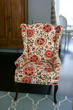 suzani fabric on wing back chair.