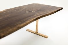 Gorgeous raw wood table top gets finished off with gold accents int he table top and with gold legs #home #decor