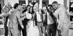 wedding bride with all of the groomsmen portrait