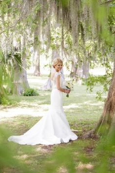 Olivia's Bridals at City Park in New Orleans came out beautiful! The combination of spring flowers, spanish moss, a beautiful dress, its perfect! Photography by New Orleans fine art wedding photographer, Erika Parker.