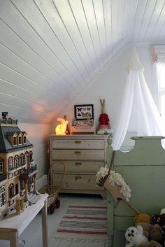 White wood attic with dollshouse and rabbits