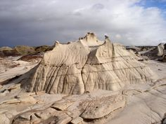 Bisti/De-Na-Zin Wilderness, or Bisti Badlands, Farmington, New Mexico - an expanse of undulating mounds and unusual eroded rocks covering 4,000 acres in the high desert of the San Juan Basin.