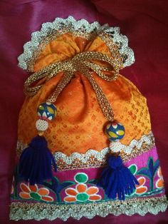 Orange brocade potli with embroidered border!