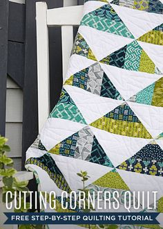 Triangle quilt with masculine colors.