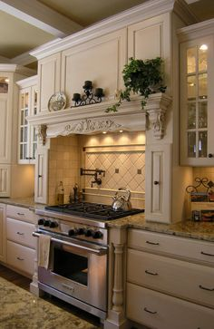 love the stove area, mantel style range hood, pull out cabinets next to stove top, counter space next to stove before cabinets, pot filler faucet