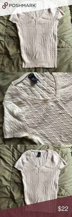 Gap Stretch Cable Knit - Great for Spring Layering So comfortable and soft. I love to wear this in the spring, because it's breathable and gives a little more warmth and chic style than a T-shirt. Color is a warm white. I'm sad to see this one go, because it's so nice, but it fits a little snug for my tastes. The whole shirt and waistband stretches to fit your proportions, but the thicker fabric is flattering, not clingy. This is GAP stretch brand. Size M. GAP Tops Tunics