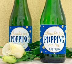 "Hosting a baby shower?  Thanks your guests for ""popping on by"" with personalized mini champagne bottle labels"