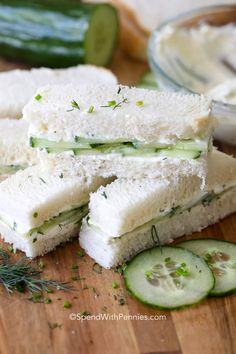 Cucumber Sandwiches are a delicious and refreshing sandwich. Layers of thin cucumbers and fresh herbed cream cheese are sandwiched in soft bread and cut into bite sized pieces. Perfect for lunch or tea. Cucumber Tea Sandwiches, Tea Party Sandwiches, Finger Sandwiches, Funeral Sandwiches, Appetizer Sandwiches, Sandwiches For Lunch, Healthy Sandwiches, Gourmet Recipes, Appetizer Recipes