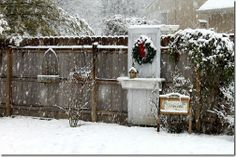 old white door with shelf and christmas wreath in garden