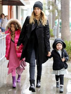 Coordinating: The trio matched in boots as they braved the wet weather...