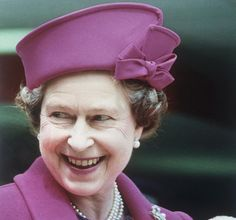 The Queen sticks to her signature look during an outing in London on June 2, 1989, matching her hat to the rest of her purple ensemble.