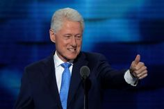 Bill Clinton gives a thumbs-up at the convention.
