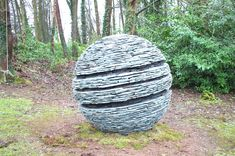 'Sliced and Opened Up' Dark Slate Ball Drystone Sculpture by Max Nowell Sculpture;  about 4 feet in diameter