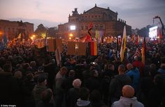 \'Do not let Germany be dragged back to chaos and destruction\': EDL founder Tommy Robinson speaks to 40,000 strong crowd at the Pegida anti-immigrant rally in Germany Police braced for violence as far-right Pegida group descends on Dresden for rally to celebrate its first anniversary Thousands of Germany\'s far-right have been met by many more anti-fascist counter-protesters mocking the rally English Defence League founder and former leader Tommy Robinson made a guest appearance at the…