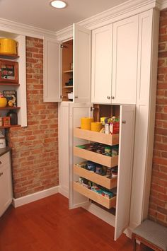 Remodeled kitchen with pullout pantry by Neal's Design Remodel.