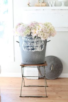 A statement centerpiece in a nice vintage bucket; of course, filled with hydrangeas makes it even better.