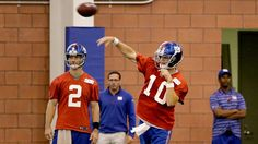 New York Giants quarterback Eli Manning (10) throws the ball during organized team activity in East Rutherford, N.J., Monday, June 1, 2015. (AP Photo/Seth Wenig)