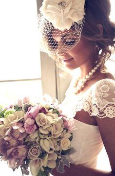 Bride's messy updo birdcage veil bridal hair Toni Kami Wedding Hairstyles ♥ ❷ Wedding hair Lovely wedding photography idea pearls lace