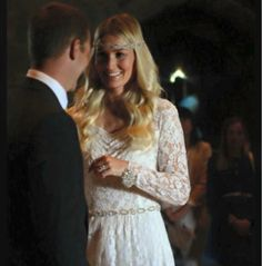 Lara wearing an original 1950's lace long sleeve wedding dress from our collection. Our Boho babe