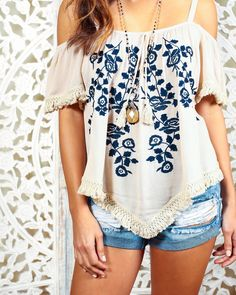 We love boho tops and our Holli Tank is essential! A sweet taupe tank with intricate navy embroidery. Love the tassle detail on the sleeves and hem. Adjustable straps allow you to have the perfect fit!