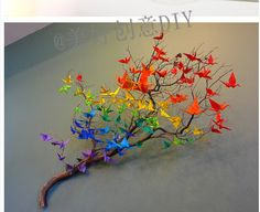 Reception Decor: Branch centerpieces with origami cranes