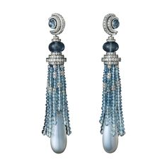 Earrings from Cartier's Panthère de Cartier collection. White gold, moon stones, aquamarines, diamonds