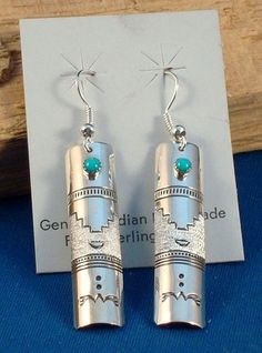 Native American Navajo Jewelry hand made Sterling Silver Dangling Earrings with Turquoise Stone Accent by Amanda Tahe. $24.99 with Free Shipping. Just Click on the above picture to be taken to the Ebay listing.
