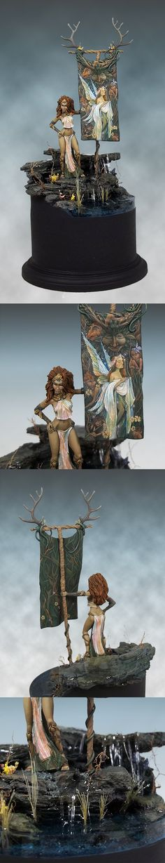 """""""The Herald of Gwynhyfar"""" This piece took home the ReaperCon 2014 Painting Contest Best in Show. It's a lightly modified Dark Sword model with a scratch built banner accented by Dark Sword antlers. The painting on the banner is all freehand based on and inspired by the artwork of Brian Froud"""