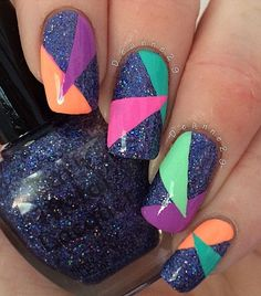 Multi colored glitter abstract nail art design. Give a twist to your plain blue glitter nails by adding random and colorful patterns on top.