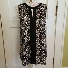 """Vince Camuto Top NWT. Lightweight Tunic. Sleeveless. Black & Cream Design. Open Triangle in Front. Black Trim down Front and Around Neck.  Machine Washable. 28"""" Length in Front. 30 1/2"""" in Back. Eye Hook Closure. 100% Poly. Vince Camuto Tops Tunics"""