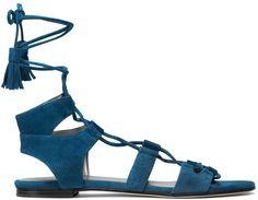 a must have for this spring and summer: cobalt blue lace up sandals. love the tassel detail!