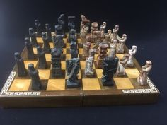 BEAUTIFUL HAND MADE IN KOREA CHESS SET CONSISTING OF HINGED WOOD BOX/GAME BOARD WITH INLAY WOOD TILES AND HAND CARVED STONE PLAYING PIECES. BEAUTIFUL CENTERPIECE GAME FOR ENTERTAINING.