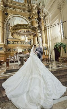 The outstanding bridal gown with a 5 meters tail