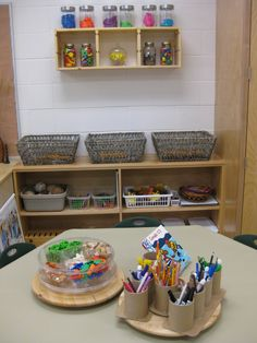I love the before and after pictures of this class. The bright colours have been swapped for Neutrals, a much calmer environment for children to be in. Our Reggio Emilia-Inspired Classroom Transformation: September 2011 Classroom Layout, Classroom Organisation, New Classroom, Classroom Setting, Classroom Design, Kindergarten Classroom, Classroom Decor, Classroom Pictures, Kindergarten Rocks