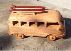 Dimensions are apprx. 5 H x 5W x 8.5 L. Handmade from red oak . Satin lacquer finish. Optional 2 surfboards, roof rack as shown + $25... Longboards