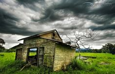Stormy afternoon clouds envelop the sky above an abandoned farm shed Building Photography, Landscape Photography, Photography Ideas, Abandoned Buildings, Abandoned Places, Underground Shelter, Farm Shed, Architectural Salvage, Bellisima