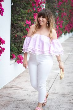 Miami fashion blogger Stephanie Pernas wearing an off the shoulder pom pom top and white jeans