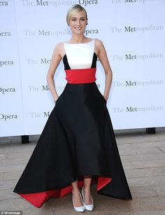 Piece of art: The Bridge star dazzled in her black gown with red underside and matching waist, with white bib, teamed with white stilettos, ...