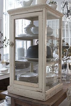 Lovely cabinet that would be beautiful on a dining room credenza or in an entry way....or....