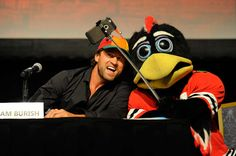 Former #Blackhawks player Adam Burish and Tommy Hawk take a selfie on stage. #BHC2016